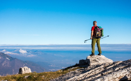 Hiker on the top in mountains. Travel sport lifestyle concept