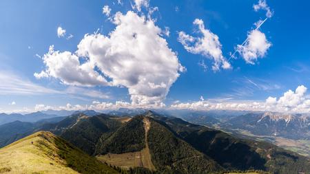 Beautiful mountain panorama on Italian Alps with blue sky and clouds. Zdjęcie Seryjne