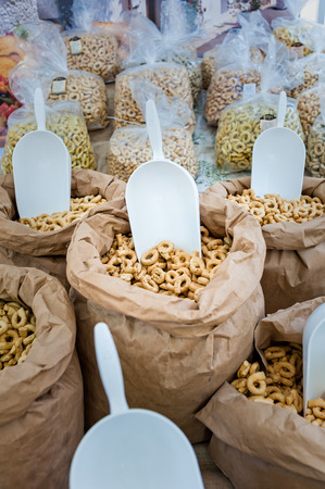 Taralli - traditional Italian snack food typical of Apulia regional cuisine on the market in Puglia in Italy. Zdjęcie Seryjne
