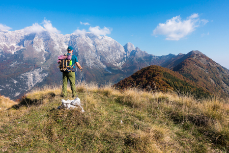 Man hiker watch the landscape of  mountain in autumn from the mountain top