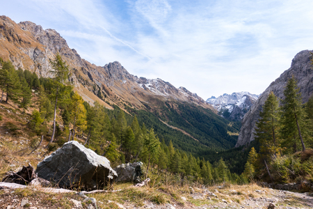 Mountains landscape with blue sky and clouds, natural summer background. Alps, Friuli, Italy.