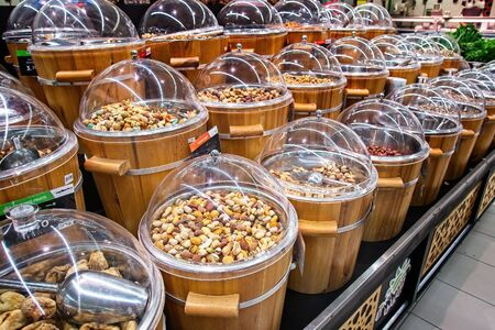 Dried fruits for sale on the market in wooden buckets with lids