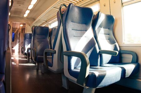 Interior of a passenger train with empty seats. Standard-Bild