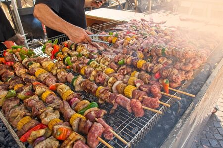 Skewers of mixed meats and vegetables cooked on the grill.
