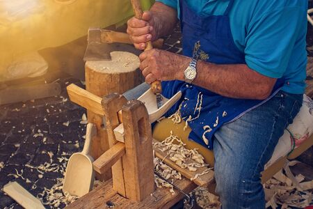 Craftsman carpenter builds wooden tools.