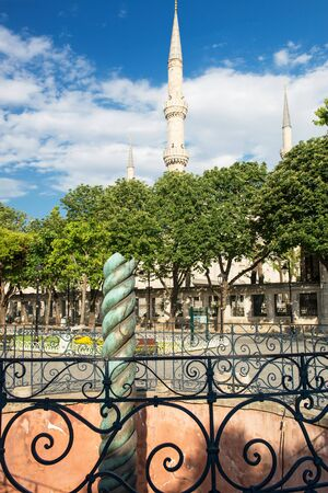 The Serpent Column and Blue Mosque minarets in Istanbul, Turkey  Constantine the Great moved the Serpent Column from the greek Temple of Apollo at Delphi to the Hippodrome in Constantinople   photo