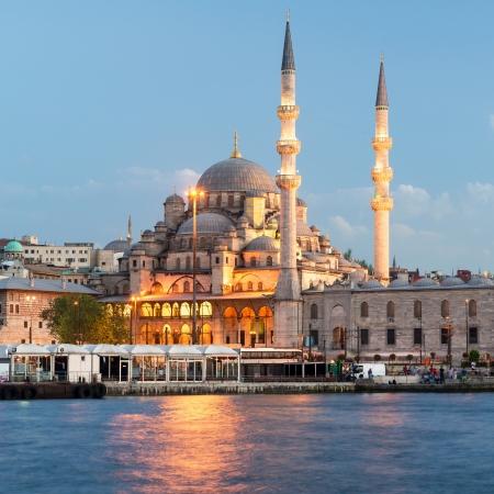 Mosque near the Galata Bridge at night in Istanbul, Turkey