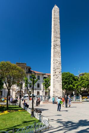 Tourists visiting the Walled Obelisk at the Hippodrome on may 26, 2013 in Istanbul, Turkey  The Walled Obelisk was built by the Byzantine Emperor Constantine Porphyrogenitus in the 10th century