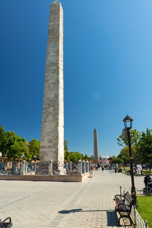 Tourists visiting the ancient Hippodrome on may 26, 2013 in Istanbul, Turkey  The Walled Obelisk  front  and the Obelisk of Thutmosis III  back  are the greatest monuments of Byzantine Culture