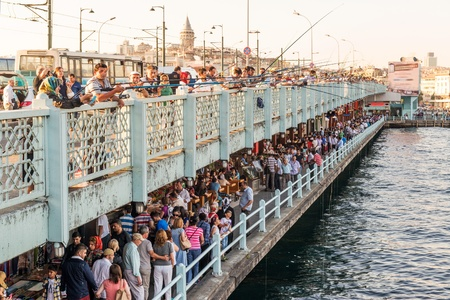 Fishermen and tourists are on the Galata Bridge on may 26, 2013 in Istanbul, Turkey  The Galata Bridge is one of the main attractions of Istanbul
