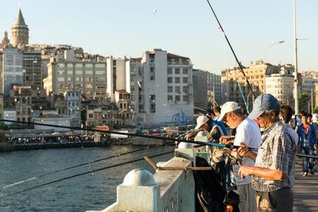 Fishermen are on the Galata Bridge on may 26, 2013 in Istanbul, Turkey  The Galata Bridge is one of the main attractions of Istanbul