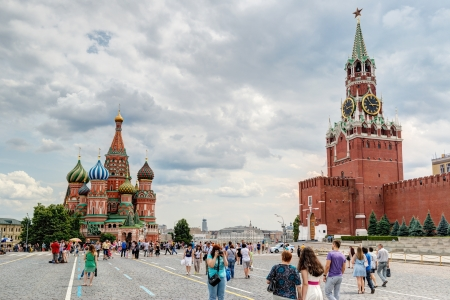 Tourists visiting the Red Square on july 13, 2013 in Moscow, Russia  St  Basil Stock Photo - 21039435