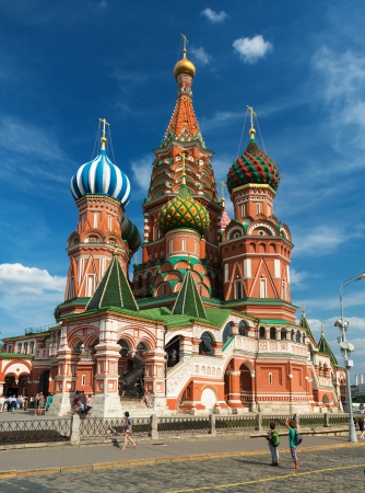 Tourists visiting the Saint Basil cathedral on the Red Square in Moscow