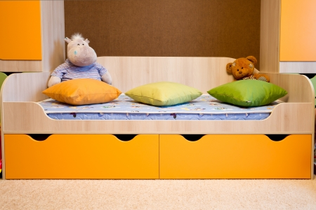 Toys lie in a children room photo