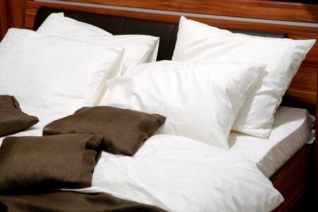 Nice pillows on a contemporary bed photo