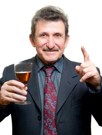 penury: Elder businessman man toasting with glass isolated on white Stock Photo