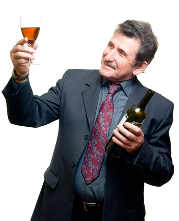 Elder businessman with glass of red wine isolated on white photo