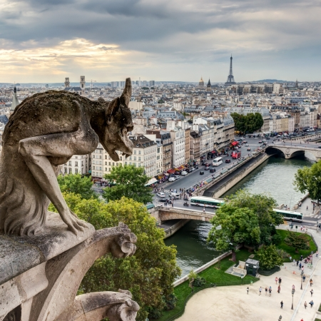 chimera: Chimera  gargoyle  of the Cathedral of Notre Dame de Paris overlooking the Eiffel Tower in Paris, France Stock Photo