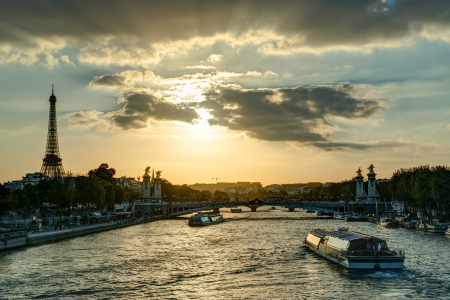 The River Seine with the Eiffel tower at sunset in Paris