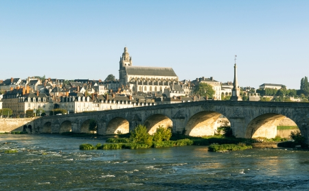 Old bridge over the Loire in Blois, France. Cathedral of Blois