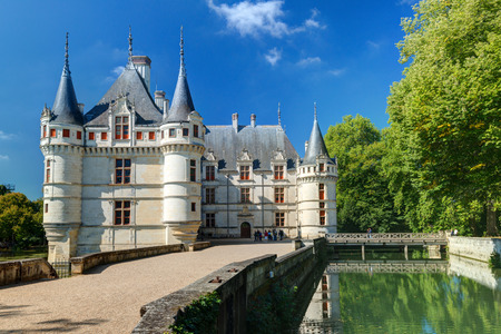 monument valley view: Tourists visiting the chateau de Azay-le-Rideau, France  This castle is located in the Loire Valley, was built from 1515 to 1527, one of the earliest French Renaissance chateaux
