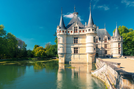 earliest: Tourists visiting the chateau de Azay-le-Rideau, France  This castle is located in the Loire Valley, was built from 1515 to 1527, one of the earliest French Renaissance chateaux