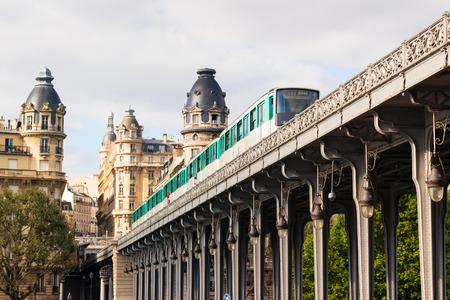 Metro runs high between buildings in Paris, France