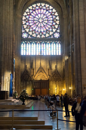 tourist destinations: Tourists visiting the Notre Dame de Paris on september 25, 2013 in Paris  The cathedral of Notre Dame is one of the top tourist destinations in Paris  Editorial