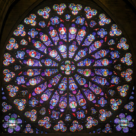 3rd century: Rose stained glass window of Notre Dame Cathedral on september 25, 2013 in Paris  Notre Dame Cathedral was built in the 3rd century and is one of the main attractions of Paris