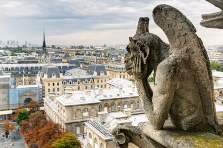 chimera: Chimera  gargoyle  of the Cathedral of Notre Dame de Paris overlooking Paris, France
