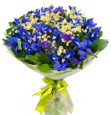 Bouquet of blue irises and daisies isolated on white background