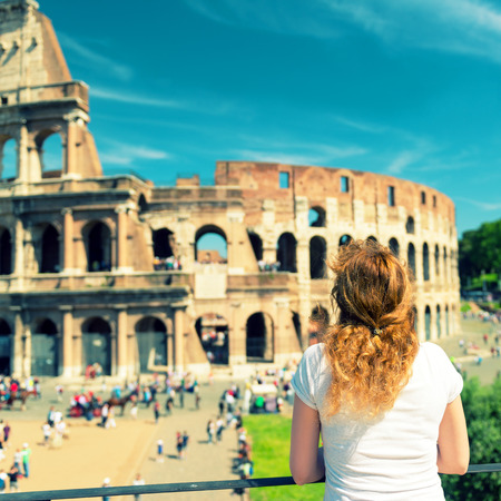 Young female tourist looks at the Colosseum in Rome, Italy  Vintage photo