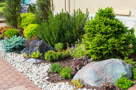 hedges: Natural stone landscaping in home garden Stock Photo