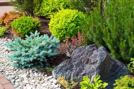 Natural stone landscaping in home garden 免版税图像