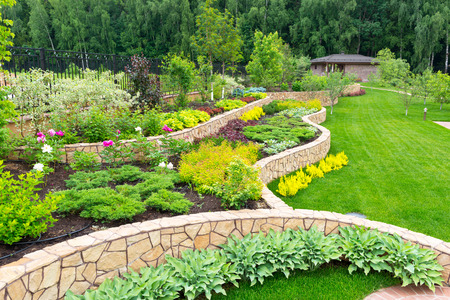 Natural stone landscaping in home garden Banco de Imagens