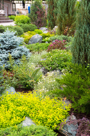 landscaped garden: Natural stone landscaping in home garden Stock Photo