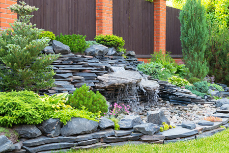 landscape garden: Natural stone landscaping in home garden Stock Photo