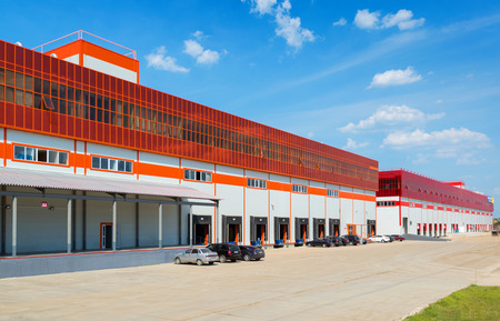 Modern warehouses on a background of blue sky