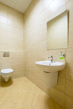 Small clean toilet in a public building photo