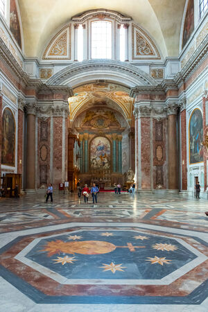 martiri: Tourists visit the Basilica of St. Mary of the Angels and the Martyrs (Santa Maria degli Angeli e dei Martiri), built inside the Baths of Diocletian in the 16th century by Michelangelo, Rome