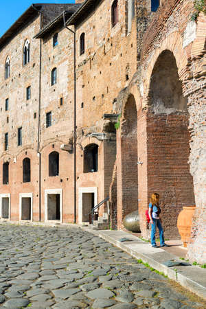 Young female tourist visits the Market of Trajan in Rome, Italy photo