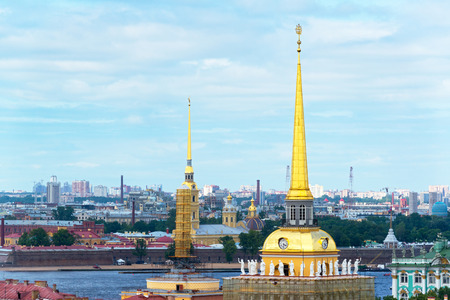 View of Saint Petersburg, Russia. Gilded spire of the Admiralty, and Saints Peter and Paul Cathedral in the background. photo