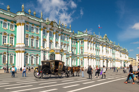 ST PETERSBURG, RUSSIA - JUNE 14, 2014: The Winter Palace, from Palace Square, was, from 1732 to 1917, the official residence of the Russian monarchs.