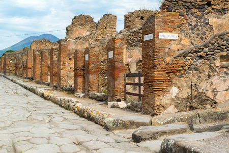 1st century: Street in the ancient Roman city of Pompeii. Pompeii is an ancient Roman city died from the eruption of Mount Vesuvius in the 1st century. Stock Photo