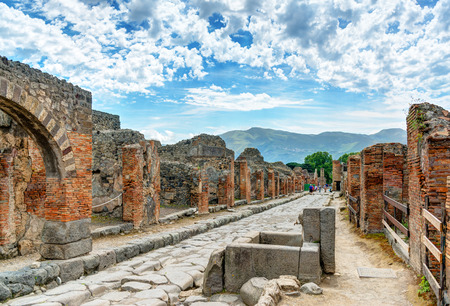 Street in Pompeii, Italy. Pompeii is an ancient Roman city died from the eruption of Mount Vesuvius in the 1st century.