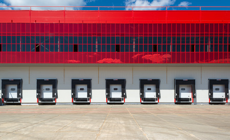 Front view of loading docks of modern warehouse