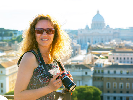 pietro: Young woman photographs the Cathedral of St. Peter (San Pietro) in Rome, Italy Stock Photo
