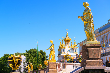 petrodvorets: ST PETERSBURG, RUSSIA - JUNE 15, 2014: Peterhof Palace (Petrodvorets)  with Grand Cascade. The Peterhof Palace included in the UNESCO Editorial