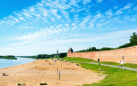 recognised: NOVGOROD THE GREAT, RUSSIA - JUNE 12, 2014: Panorama: Volkhov river, the beach and the ancient Kremlin wall. UNESCO recognised Novgorod as a World Heritage Site in 1992.