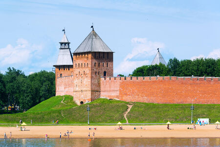 volkhov: NOVGOROD THE GREAT, RUSSIA - JUNE 12, 2014: The Kremlin walls on the bank of the Volkhov river. UNESCO recognised Novgorod as a World Heritage Site in 1992.